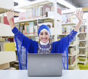 Happy female muslim in library Royalty Free Stock Photo