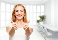Happy female in the office Stock Photo