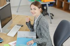 Happy female office worker. Female Stock Images