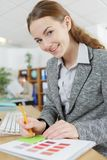 Happy female office worker. Female Royalty Free Stock Images