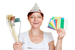 Painter with color samples. Happy female painter with color samples and brushes Royalty Free Stock Photography