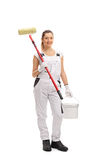 Happy Female Painter Holding Paint Roller And Color Bucket Stock Photos