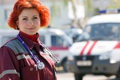 Happy female paramedic stock image
