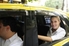 Happy female passenger inside of a taxi Stock Image