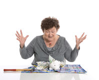 Happy female pensioner after smashing her piggy box. Money conce Stock Photos