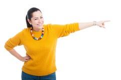 Happy female pointing or indicate something Stock Image