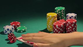 Happy female poker player showing best poker combination, royal flush hand stock video