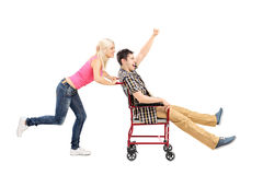 Happy female pushing a man in wheelchair Stock Photography