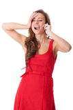 Happy female in red dress chat over mobile Stock Image