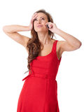Happy female in red dress talks over mobile phone Stock Photos