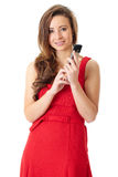 Happy female in red dress text using mobile phone. Young happy attractive female in red dress text using her mobile phone, shoot over white background Royalty Free Stock Photo