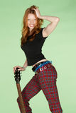 Happy Female Red Head Rock and Roll Guitar Player. Happy Young Female Red Head Rock and Roll Guitar Player Royalty Free Stock Images