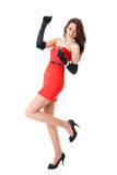 Happy female in red strapless dress, isolated Royalty Free Stock Photo