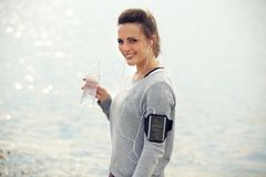 Happy Female Runner with Bottled Water Royalty Free Stock Photos