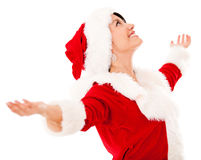 Happy female Santa with arms open Royalty Free Stock Image