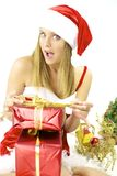 Happy female Santa Claus preparing packages Royalty Free Stock Photos
