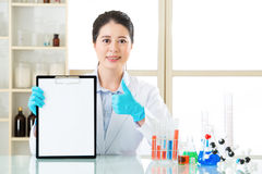 Happy female scientist discover good result and thumb up Royalty Free Stock Images