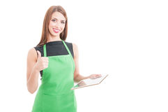 Happy female seller with tablet showing thumbup Stock Photography