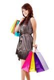 Happy female shopper. Stock image of happy female shopper isolated on white background stock images