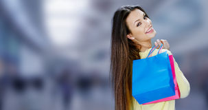 Happy female shopper carrying her purchases Royalty Free Stock Image