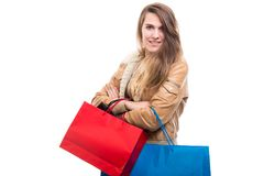 Happy female shopper posing with colorful shopping bags Royalty Free Stock Image