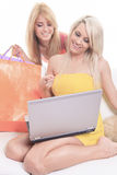 A Happy female shoppers smiling - isolated over a Royalty Free Stock Photos