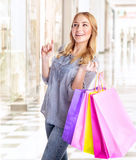 Happy female with shopping bags Stock Photography