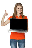 Happy female showing a laptop screen and gesturing thumb up. Happy casual female showing a laptop screen and gesturing thumb up sign, isolated over a white stock images