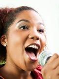 Happy Female Singer Performing In Recording Studio Stock Image