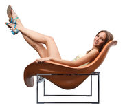 Happy female sitting in the chair Royalty Free Stock Photography