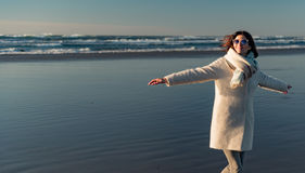 Happy female situating on seaside Royalty Free Stock Photos