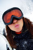 Happy female skier. Portrait of a happy female skier making lips in kiss Royalty Free Stock Image