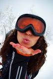 Happy female skier. Portrait of a happy female skier making lips in kiss Stock Image