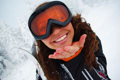 Happy female skier. Portrait of a happy female skier making lips in kiss Royalty Free Stock Images