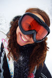 Happy female skier. Smiling in snow forest Royalty Free Stock Photo