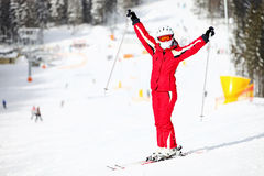Happy female skier on mountain slope Stock Photos