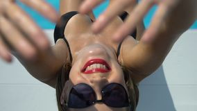 Happy female smiling near swimming pool with sunscreen lotion on skin, tanning. Stock footage stock video footage