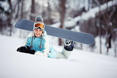 Happy female snowboarder resting Royalty Free Stock Photos
