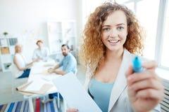 Happy female speaker sharing sales techniques stock image