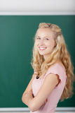 Happy Female Student Against Chalkboard Royalty Free Stock Photos