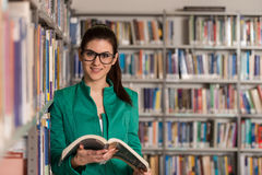Happy Female Student With Book In Library Stock Photography