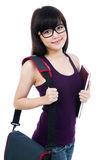 Happy Female Student Carrying Book And Bag Stock Images