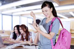 Happy female student celebrating her success stock photography