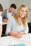 Happy female student in college stock image
