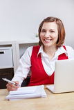 Happy female student at desk Royalty Free Stock Photography