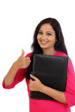 Happy female student holding folder Stock Photography