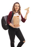 Happy female student holding a paper bag and a sandwich Royalty Free Stock Photography