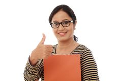 Happy female student holding text book Stock Photography