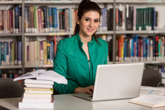 Happy Female Student With Laptop In Library Royalty Free Stock Image