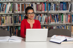 Happy Female Student With Laptop In Library Royalty Free Stock Photo